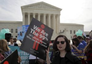 Supporters of contraception rally before Zubik v. Burwell, an appeal brought by Christian groups demanding full exemption from the requirement to provide insurance covering contraception under the Affordable Care Act, is heard by the U.S. Supreme Court in Washington, U.S., March 23, 2016. REUTERS/Joshua Roberts/File Photo